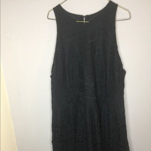 A black formal dress with like lace material .